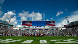 a crowd of people watching a football game: Sep 30, 2018; Jacksonville, FL, USA; General view of US Military airplanes flying over the stadium during the national anthem prior to the game between the New York Jets and Jacksonville Jaguars at TIAA Bank Field.