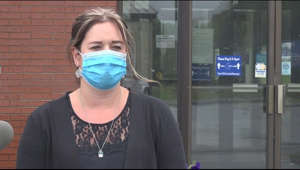 a woman standing in front of a window: Dozens infected with COVID-19 after wedding in Millinocket