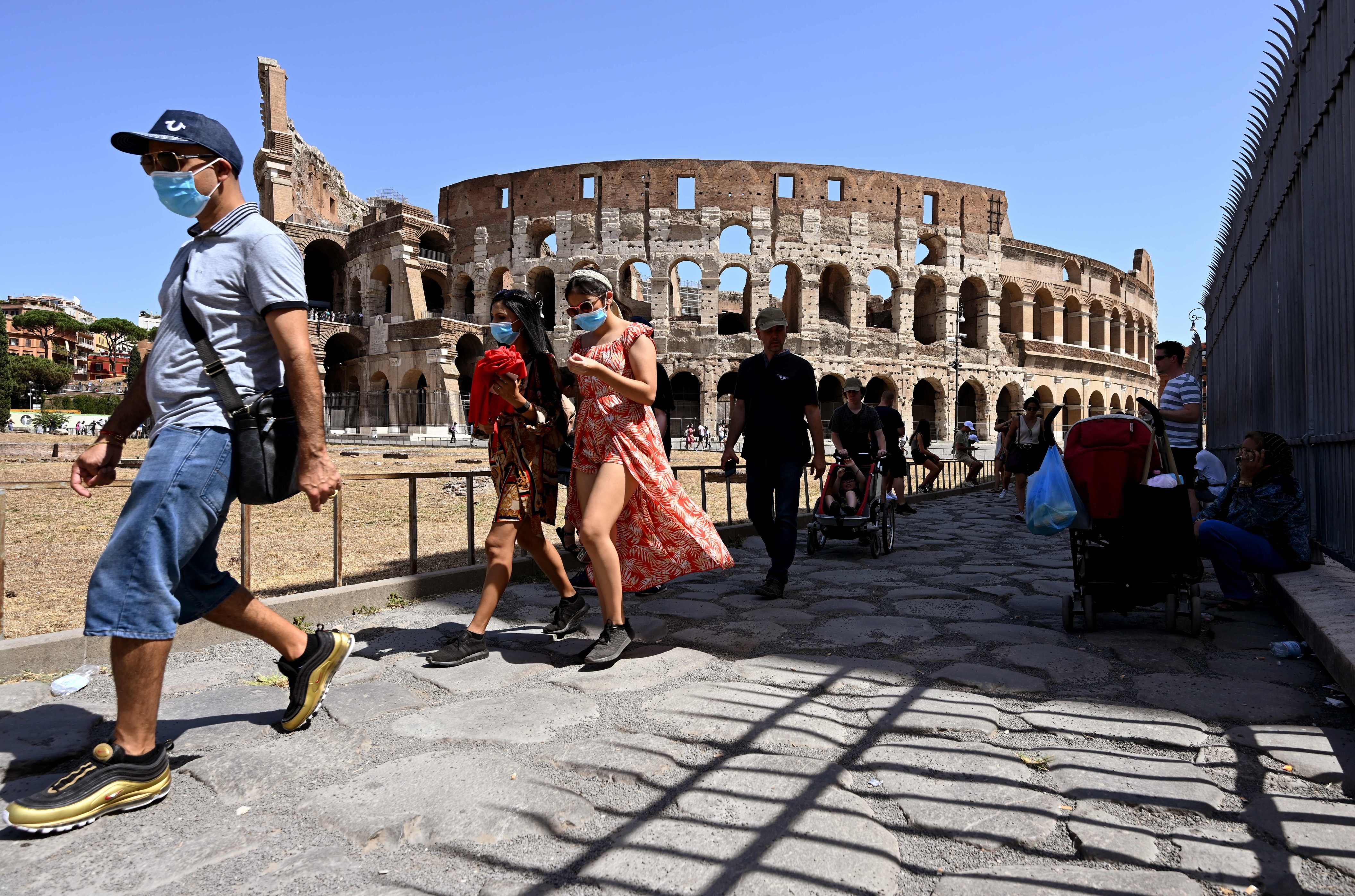 Vacationers, migrants drive Italy's surge in COVID cases - International