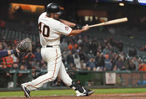 a baseball player swinging a bat at a ball: The designated hitter is now being used by both leagues. Most insiders think that the DH is now here to stay in the National League, so with hitting pitchers about to go the way of the dinosaur, it's worth taking a look at those hurlers who raked (relatively speaking).