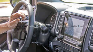 a person sitting in a car: 2021 Nissan Frontier Spy Shots Speedometer