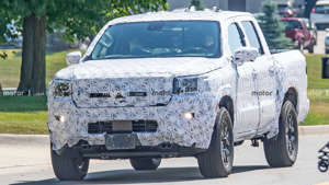 a truck driving down a dirt road: 2021 Nissan Frontier Spy Shots Face