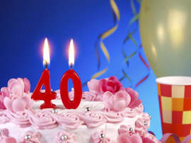 a birthday cake with lit candles: 40th birthday cake