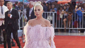 "a person standing in front of a crowd: The 'Born This Way' hitmaker first opened up about her illness in her 2017 documentary 'Lady Gaga: Five Foot Two'.  Fibromyalgia is a condition that causes pain all over the body, and causes extreme tiredness, muscle stiffness, trouble concentrating and problems sleeping. Though there is no cure, there is treatment that can help relieve pain although Gaga had to skip a concert in Brazil due to ""severe pain""."