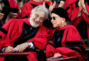 Ruth Bader Ginsburg et al. sitting around each other: Opera tenor Placido Domingo, left, chats with Supreme Court Justice Ruth Bader Ginsburg, right, during Harvard University's 360th commencement exercises, on the school's campus, in Cambridge, Mass., Thursday, May 26, 2011.