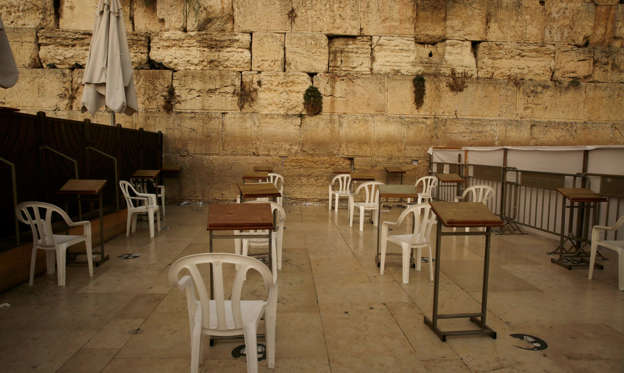 Slide 1 of 59: Chairs for women to worship at the Western Wall in the Old City of Jerusalem, the holiest site where Jews can pray, sit empty, Friday, Sept. 18, 2020, on the first day of a nationwide three-week lockdown to curb the spread of the Coronavirus.