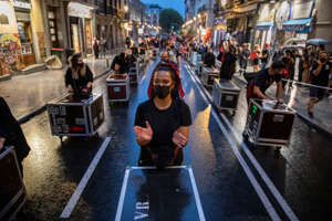 "MADRID, SPAIN - SEPTEMBER 17: Protesters wearing protective masks applause and hit flight cases as they keep social distance during a demonstration along the streets of Madrid on September 17, 2020 in Madrid, Spain. Spain saw demonstrations in some 28 cities under the slogan ""Red Alert"", in a cry for more support of the entertainment and events sector, in paralysis since the start of the Coronavirus pandemic. (Photo by Pablo Blazquez Dominguez/Getty Images)"