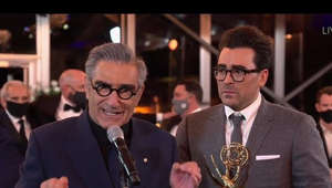 Eugene Levy, Daniel Levy are posing for a picture: The team from Schitt's Creek wins the Emmy for Outstanding Comedy Series.