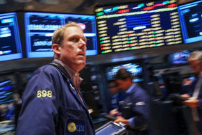 Traders work on the floor of the New York Stock Exchange on August 22, 2014 in New York City.