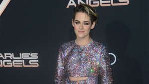 "Kristen Stewart holding a sign: The 'Twilight' star opened up about her sexuality during the opening monologue of 'Saturday Night Live' in 2017. Referring to a tweet from President Donald Trump that encouraged her then-boyfriend to dump her, she quipped: ""If you didn't like me then you probably won't like me now as I'm so gay, dude."""