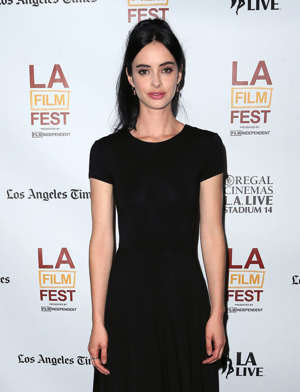 text, whiteboard: Krysten Ritter attends the 2014 Los Angeles Film Festival screening of 'The Road Within'