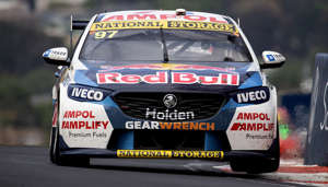 a car driving on a race track: The Shane van Gisbergen/Garth Tander Commodore during the Bathurst 1000.