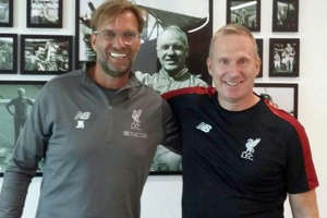 a person standing in front of Jurgen Klopp, Bill Shankly posing for the camera: Gronnemark has been working with Liverpool for the past two years