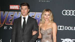 Colin Jost, Scarlett Johansson are posing for a picture