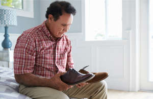 a man sitting in front of a window: The early signs of dementia include changes in judgment or decision making. This is especially worrying because it can prevent you from seeking medical care.
