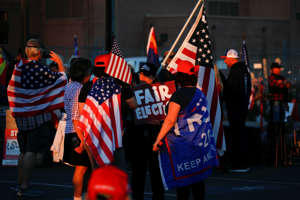 "Supporters of U.S. President Donald Trump gather for a ""Stop the Steal"" protest after the 2020 U.S. presidential election was called for Democratic candidate Joe Biden, at the Maricopa County Tabulation and Election Center (MCTEC), in Phoenix, Arizona, U.S., November 11, 2020. REUTERS/Jim Urquhart"