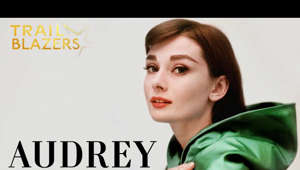 text: From the multi award-winning producers of 'McQueen' and 'Churchill' comes Audrey, an intimate look at Audrey's life, with access to exclusive never-before-seen footage from her family's personal collection. Providing an unprecedented and insightful view on Audrey, her life and her dreams, aspirations and her everlasting legacy.     Audrey Hepburn won her first Academy Award at the age of 24, and went on to become one of the world's greatest cultural icons: a once-in-a-generation beauty, and legendary star of Hollywood's Golden Age, whose style and pioneering collaboration with Hubert de Givenchy continues to inspire. But who was the real Audrey Hepburn?     Malnourished as a child, abandoned by her father, and growing up under Nazi occupation in Holland, Hepburn faced a life-long battle with the traumas of her past, which thwarted her dreams of becoming a ballet dancer, and cast a shadow over her personal life. Yet she found inner peace, using her superstardom for good as a global ambassador for UNICEF, and bringing her life full circle: first a victim of war, then a source of relief to millions.     A hybrid of rare archive, cinematic dance sequences, and intimate interviews with those who knew her best, this film brings a truly extraordinary woman to life, who stands as testament to the power of love and forgiveness.     The documentary feature contributions from:  Sean Hepburn-Ferrer (Audrey's son) Emma Ferrer (Audrey's granddaughter) Richard Dreyfuss (co-star) Clare Waight Keller (artistic director, Givenchy) John Loring (design director emeritus of Tiffany & Co)    Audrey is available to rent and own on digital from November 30th in the UK, December 15th in the US and December 16th in Australia. Other international markets from February 8th 2021.  Trailblazer: A person who is the first to do something; an innovator. 