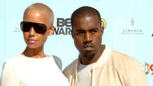 Amber Rose, Kanye West posing for the camera