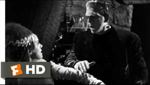 "a man sitting on a bench: Bride of Frankenstein movie clips: http://j.mp/1CMO9a7 BUY THE MOVIE: http://amzn.to/vf2H4F Don't miss the HOTTEST NEW TRAILERS: http://bit.ly/1u2y6pr  CLIP DESCRIPTION: When The Monster (Boris Karloff) realizes that his Bride (Elsa Lanchester) hates him like everyone else, he blows up the castle.  FILM DESCRIPTION: This greatest of all Frankenstein movies begins during a raging thunderstorm. Warm and cozy inside their palatial villa, Lord Byron (Gavin Gordon), Percy Shelley (Douglas Walton), and Shelley's wife Mary (Elsa Lanchester) engage in morbidly sparkling conversation. The wicked Byron mockingly chastises Mary for frightening the literary world with her recent novel Frankenstein, but Mary insists that her horror tale preached a valuable moral, that man was not meant to dabble in the works of God. Moreover, Mary adds that her story did not end with the death of Frankenstein's monster, whereupon she tells the enthralled Byron and Shelley what happened next. Surviving the windmill fire that brought the original 1931 Frankenstein to a close, the Monster (Boris Karloff) quickly revives and goes on another rampage of death and destruction. Meanwhile, his ailing creator Henry Frankenstein (Colin Clive) discovers that his former mentor, the demented Doctor Praetorius (Ernst Thesiger), plans to create another life-sized monster -- this time a woman! After a wild and wooly ""creation"" sequence, the bandages are unwrapped, and the Bride of the Monster (Elsa Lanchester again) emerges. Alas, the Monster's tender efforts to connect with his new Mate are rewarded only by her revulsion and hoarse screams. ""She hate me,"" he growls, ""Just like others!"" Wonderfully acted and directed, The Bride of Frankenstein is further enhanced by the vivid Franz Waxman musical score; even the film's occasional lapses in logic and continuity (it was trimmed from 90 to 75 minutes after the first preview) are oddly endearing. Director James Whale was memorably embodied by Ian McKellen in the Oscar-winning 1998 biopic Gods and Monsters.  CREDITS: TM & © Universal (1935) Cast: Colin Clive, Boris Karloff, Ernest Thesiger, Valerie Hobson, Elsa Lanchester Director: James Whale Producer: Carl Laemmle Jr. Screenwriters: John L. Balderston, Josef Berne, Lawrence G. Blochman, Morton Covan, Robert Florey, William Hurlbut, Tom Reed, Edmund Pearson, R.C. Sherriff, Philip MacDonald, Mary Shelley  WHO ARE WE? The MOVIECLIPS channel is the largest collection of licensed movie clips on the web. Here you will find unforgettable moments, scenes and lines from all your favorite films. Made by movie fans, for movie fans.  SUBSCRIBE TO OUR MOVIE CHANNELS: MOVIECLIPS: http://bit.ly/1u2yaWd ComingSoon: http://bit.ly/1DVpgtR Indie & Film Festivals: http://bit.ly/1wbkfYg Hero Central: http://bit.ly/1AMUZwv Extras: http://bit.ly/1u431fr Classic Trailers: http://bit.ly/1u43jDe Pop-Up Trailers: http://bit.ly/1z7EtZR Movie News: http://bit.ly/1C3Ncd2 Movie Games: http://bit.ly/1ygDV13 Fandango: http://bit.ly/1Bl79ye Fandango FrontRunners: http://bit.ly/1CggQfC  HIT US UP: Facebook: http://on.fb.me/1y8M8ax Twitter: http://bit.ly/1ghOWmt Pinterest: http://bit.ly/14wL9De Tumblr: http://bit.ly/1vUwhH7"