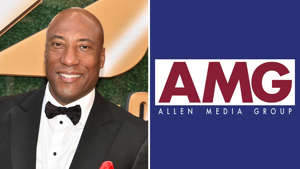 Byron Allen wearing a suit and tie