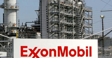 Exxon reports third straight quarter of losses with revenue down nearly 30%