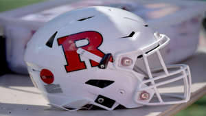 a close up of a helmet on a table: Sep 15, 2018; Lawrence, KS, USA; A general view of a Rutgers Scarlet Knights helmet during the game against the Kansas Jayhawks at Memorial Stadium. Kansas won 55-14.
