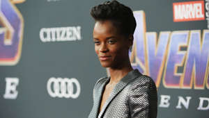 "a woman holding a sign: LOS ANGELES, CA - APRIL 22: Letitia Wright attends the Los Angeles World Premiere of Marvel Studios' ""Avengers: Endgame"" at the Los Angeles Convention Center on April 23, 2019 in Los Angeles, California. (Photo by Jesse Grant/Getty Images for Disney)"