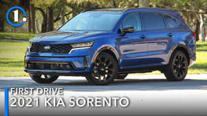 a blue truck parked in front of a car: 2021 Kia Sorento Review