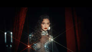 "a person in a dark room: Sabrina Claudio - Warm December (Official Music Video) Stream/Download: http://sabrinaclaudio.lnk.to/WarmDecemberID  Production Company: Antidote Digital Directors: Prince + Jacob Executive Producers: Sacha Smith & Jenn Khoe Producer: Ben Kang DP: Luis ""Panch"" Perez Production Designer: Jonnie Prey  Follow Sabrina Claudio: Website: http://sabrinaclaudio.com Instagram: https://instagram.com/sabrinaclaudio Facebook: https://facebook.com/sabrinaclaudiomusic Twitter: https://twitter.com/sabrinaclaudio SoundCloud: https://soundcloud.com/sabrina-claudio  #SabrinaClaudio #WarmDecember #OfficialVideo"