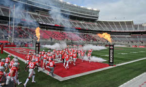 Ohio State players run onto the field before a game in September.