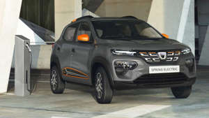 a car parked in front of a building: Dacia Spring Electric (2021)