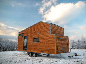 a house covered in snow:  Tiny house owners have to winterize their homes to ensure everything runs smoothly when the cold weather arrives.  Pipes can freeze and burst, so tiny house owners need to spend time and money insulating pipes, tanks, and water connections that are on the outside and underneath their home.  They also have to worry about getting kicked out of campgrounds, their composting toilets failing to work effectively, and animals hiding under their homes.  Visit Insider's homepage for more stories. Tiny house owners are often confronted with unique issues that traditional homeowners don't deal with, especially during the winter. When the temperature drops and the cold weather rolls in, tiny house owners across the country begin prepping their homes for winter to ensure everything runs smoothly all season long. Here are seven things tiny house owners told Insider they need to think about as the cold creeps in.Read the original article on Insider