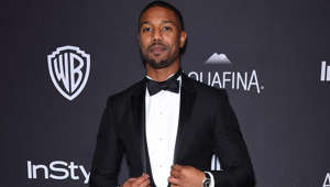 Michael B. Jordan wearing a suit and tie