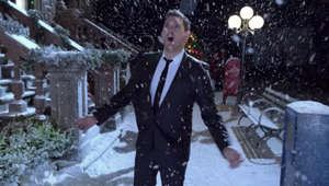 a man that is standing in the snow: Listen to Michael's ❤️ at Christmas Playlist: https://MichaelBuble.lnk.to/loveatchristmas  From the album 'Christmas' (Deluxe Special Edition) Stream or Download: http://michaelbuble.lnk.to/christmas  Connect with Michael: http://www.michaelbuble.com http://www.bungalow-b.com http://www.facebook.com/michaelbuble http://www.twitter.com/michaelbuble  LYRICS: You better watch out You better not cry You better not pout I'm telling you why Santa Claus is coming to town  He's making a list He's checking it twice; He's gonna find out who's naughty or nice Santa Claus is coming to town  He sees you when you're sleeping And he knows when you're awake He knows if you've been bad or good So be good for goodness sake!  You better watch out You better not cry You better not pout I'm telling you why Cause Santa Claus is coming to town  He sees you when you're sleeping And he knows when you're awake And he knows if you've been bad or good So be good for goodness sake!  You better watch out You better not cry You better not pout I'm telling you why Santa Claus is coming to town  You better watch out You better not cry You better not pout I'm telling you why Santa Claus is coming I mean a big fat man with a long white beard He's coming to town  Michael Bublé - Santa Claus Is Coming To Town [Official Music Video]  Michael Buble