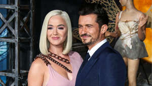 Katy Perry, Orlando Bloom posing for a picture