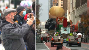 a man standing on a busy street: Macy's Thanksgiving Parade kicked off with different look this year