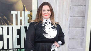 Melissa McCarthy standing in front of a building