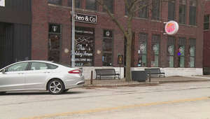 a car parked on a street corner in front of a building: Local businesses encouraged by strong start to holiday shopping season