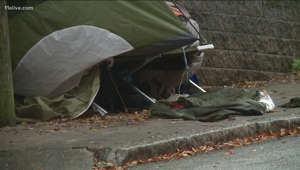 a person lying on the ground: Atlanta warming centers open ahead of lowest temps so far