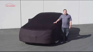 a man posing for a picture: https://www.carcovers.com/black-satin-shield.html -  The black satin shield cover is the best solution for super soft indoor dust protection. This cover is made of a high quality stretchy satin fabric that will keep your vehicle's finish will be perfectly preserved and protected.