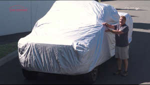 a person standing on a bed: http://www.carcovers.com/covers/truck.html - Truck Covers at CarCovers.com. Featuring our Platinum Shield Full Body Truck Cover. This is our top of the line car cover with a limited lifetime warranty. This car cover that is for all weather and provides top level protection from all the elements including rain, snow, UV rays, small hail, bird droppings and more! Soft fleece inner lining. Includes a free cable and lock for anti-theft, storage bag, microfiber 3 pack. Free shipping to all of the US and Canada!