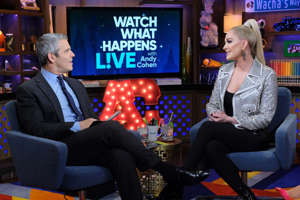 Andy Cohen et al. sitting in a chair talking on a cell phone: Jayne with Bravo host Andy Cohen. Charles Sykes/Bravo/NBCU Photo Bank via Getty Images