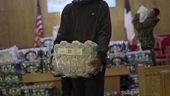 a person standing in front of a store: Flint: An American Nightmare