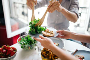 a person holding a plate of food on a table: It isn't all that difficult to eat a healthy diet on a budget, but the biggest question here is not so much about the budget as what constitutes optimum nutrition. What's considered healthy changes all the time. First eggs were evil, now they aren't; same with fat (as long as it's unsaturated); and it is a fairly sure bet that carbs, once sainted, now tainted, will go the same way. Author Michael Pollan breaks it down into three simple phrases: Eat food. Not too much. Mostly plants. By food, he means real food that your great-grandmother would recognize as food. In other words, food that is a plant or comes from plants, rather than food that is manufactured — which is, unfortunately, usually cheap and easy.Eating nutritious foods can take a bit more time and effort than stuff that comes in a box, but it's better for you and can also budget-friendly. We show you how with these 26 healthy foods and meals that cost about $1 per serving or less.Related: 12 Healthy Meal Hacks for Hectic Households