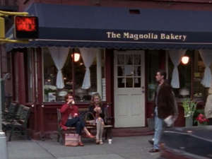 """a group of people walking in front of a store: Magnolia Bakery first appeared on """"Sex and the City"""" in a 2000 episode. HBO/Sex and the City"""