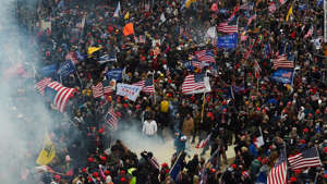 a group of people performing on stage in front of a crowd: Trump supporters clash with police and security forces as they storm the US Capitol in Washington D.C on January 6, 2021. - Demonstrators breeched security and entered the Capitol as Congress debated the a 2020 presidential election Electoral Vote Certification. (Photo by Roberto Schmidt/AFP/Getty Images)