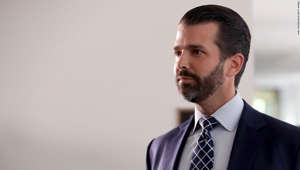Donald Trump Jr. wearing a suit and tie: WASHINGTON, DC - JUNE 12: Donald Trump Jr., the son of U.S. President Donald Trump, leaves following a second closed-door interview with members of the Senate Intelligence Committee in the Hart Senate Office Building on Capitol Hill June 12, 2019 in Washington, DC. Trump Jr. negotiated limitations with the committee after it issued a subpoena for his testimony, which will include questions about a June 2016 meeting at Trump Tower with a Russian lawyer promising incriminating information about Hillary Clinton. (Photo by Chip Somodevilla/Getty Images)