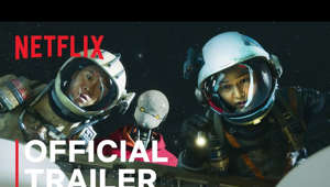a person wearing a helmet: #승리호 #SpaceSweepers #Netflix  It's a Big Universe, Full of Valuable Trash!  Song Joong-ki | Kim Tae-ri | Jin Sun-kyu | Yoo Hai-jin  These Misfits Just Might Save The World!  Get on board with the Space Sweepers  February 5, Only on Netflix.  SUBSCRIBE: http://bit.ly/29qBUt7  About Netflix: Netflix is the world's leading streaming entertainment service with over 195 million paid memberships in over 190 countries enjoying TV series, documentaries and feature films across a wide variety of genres and languages. Members can watch as much as they want, anytime, anywhere, on any internet-connected screen. Members can play, pause and resume watching, all without commercials or commitments.  Space Sweepers | Official Trailer | Netflix https://youtube.com/Netflix  Chasing after space debris and faraway dreams in year 2092, four misfits unearth explosive secrets during the attempted trade of a wide-eyed humanoid.