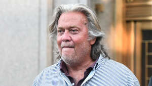 a man wearing glasses and looking at the camera: Former White House Chief Strategist Steve Bannon exits the Manhattan Federal Court on August 20, 2020 in the Manhattan borough of New York City. Bannon and three other defendants have been indicted for allegedly defrauding donors in a $25 million border wall fundraising campaign.