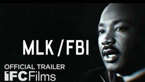 Martin Luther King, Jr. looking at the camera: Opening in theaters and on demand January 15    Director: Sam Pollard Starring: Martin Luther King  Dr. Martin Luther King Jr. is remembered today as an American hero: a bridge-builder, a shrewd political tactician, and a moral leader. Yet throughout his history-altering political career, he was often treated by U.S. intelligence and law enforcement agencies like an enemy of the state. In this virtuosic documentary, award-winning editor and director Sam Pollard (Editor, 4 LITTLE GIRLS, MO' BETTER BLUES; Director/Producer, EYEZ ON THE PRIZE, SAMMY DAVIS, JR.: I'VE GOTTA BE ME) lays out a detailed account of the FBI surveillance that dogged King's activism throughout the '50s and '60s, fueled by the racist and red-baiting paranoia of J. Edgar Hoover. In crafting a rich archival tapestry, featuring some revelatory restored footage of King, Pollard urges us to remember that true American progress is always hard-won.  #MLKFBI #IFCFilms 